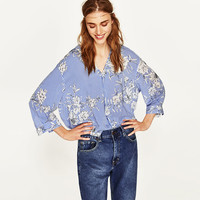 PRINTED BLOUSE WITH POLO NECK DETAILS