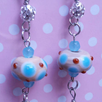 Cream blue and red polka dot Lampwork glass bead earrings with blue dangle bead
