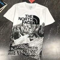 North of The North Face ® overseas dared to limit snow-capped mountains ink short sleeve T-shirt paragraphs summer men's leisure round collar joker with short sleeves