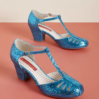 B.A.I.T. Footwear Shimmer Down Now T-Strap Heel in Blue Glitter
