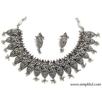 Oxidized ruby stone embedded silver ghungru hanging choker necklace and earring set