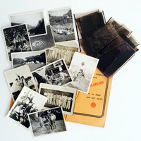 Vintage collection of negatives and black and white prints in an original Kodak photographic wallet. Collectable vintage photography.