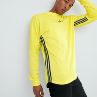 adidas Originals Authentic Long Sleeve Top In Yellow DJ2869 at asos.com