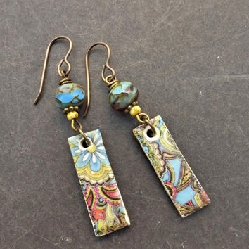 Pattern rectangle ceramic drops and bronze metal earrings. Blue, purple, yellow and white.