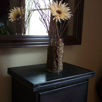 Tree bark and glass vase with real birch twigs and immortal flower