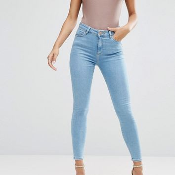 ASOS Ridley High Waist Skinny Jeans in Anais Pretty Mid Wash at asos.com