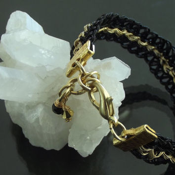 Kumihimo bracelet, coated stainless steel wire, yellow and black color