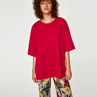 OVERSIZED EMBROIDERED T-SHIRT DETAILS