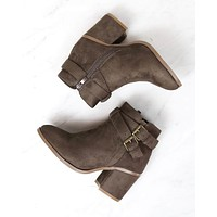 A Grand Entrance Faux Suede Ankle Bootie With Buckle Detail in More Colors