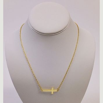 NWOT bright yellow gold cross necklace