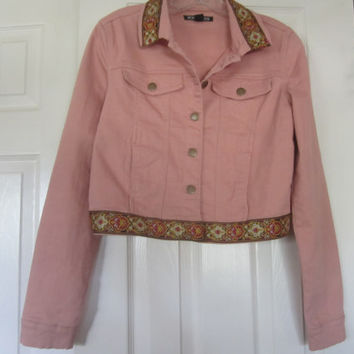 Medium pink denim jacket with embroidered embellishments. One of a kind.