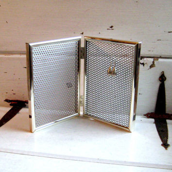Jewelry Organizer from a double hinged magnetic silver frame to display your earrings or photos