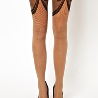 Wolford | Wolford Romance Bow Front Tights at ASOS
