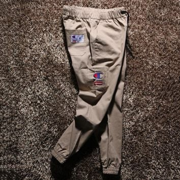 Champion summer autumn new - style bundle foot cloth trousers leisure overalls multi - pocket embroidered standard men's trousers