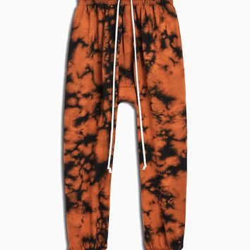 roaming track pant / orange acid