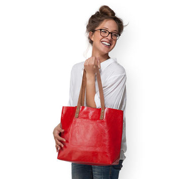 Large red leather handbag by Leah Lerner