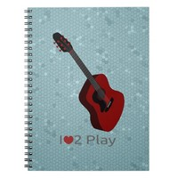 Notebook with illustration of an acoustic g guitar
