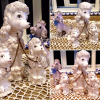 1950's Japan porcelain Poodle Figurines Lot of 4   Momma poodle with two pups   Lavender spaghetti poodle with 24k gold  Mid-Centery decor