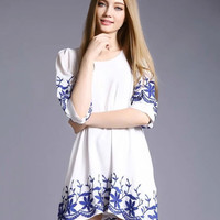 White Half Sleeves Loose Fitting Mini Dress with Blue Floral Print Detail