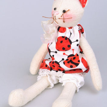 Handmade flannel fabric soft toy white cat in dress with ladybird pattern