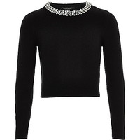 Girls black pearl trim top