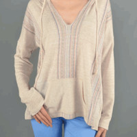 Grab attention in this Bright Sensation Thin Knit Surfer Hoodie Top! This soft blend thin knit hoodie top featured v-neckline, contrast (blue, coral, black) mixed color striped detailing at front, long sleeves, front share pocket, drawstring hooded and rel