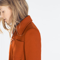 Coat with front pockets