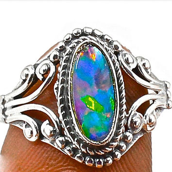Genuine Australian Natural Opal ring.Natural Boulder Opal Gemstone. Set in Sterling Silver setting.Natural Australian Boulder Opal Doublet