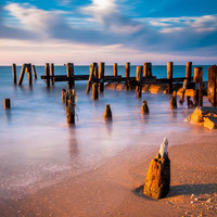 Golden light on pier pilings at Sunset Beach, Cape May, New Jersey. - Nature Fine Art Print or Gallery Wrap Canvas