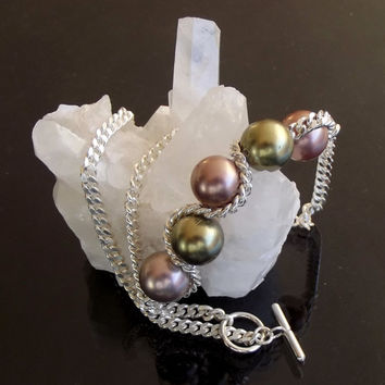 Necklace in sterling silver and color pearls