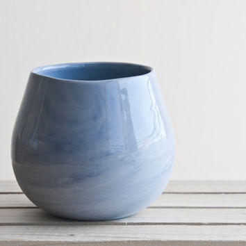 Ceramic bowl in light blue with glossy glaze.  Great for soups and desserts.modern and urban look.