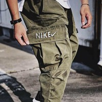 Nike Lab Cargo Nike overseas edition functional trend series 3M reflective overalls woven big pocket wei pants men and women's wear pants
