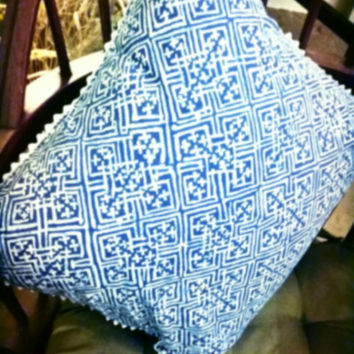 "Decorative Pillow in a Batik Blue and White Geometric Print. Trimmed in White Ric Rak. Approximately 15"" × 15"""