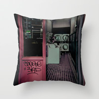 The Laundromat Throw Pillow by Paul Vayanos
