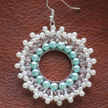 Snowflake beaded earring for the winter. Beautiful blue and shiny diamond shaped beads.