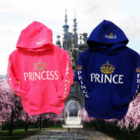 "Two ""princess"" and ""prince"" youth hoodies,swetshirts, one pink one royal blue."
