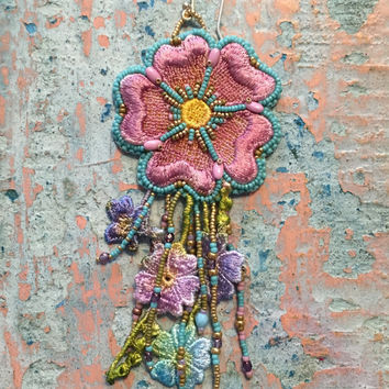 Big single bead embroidered flower earring.