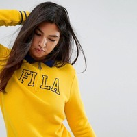 Fila Relaxed Sweatshirt With Half Zip And Varsity Logo at asos.com