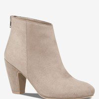 CURVED HEEL ZIP BACK BOOTIE