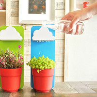 Give Your Flower Pots Their Own Rain Clouds Thanks To The Rainy Pot