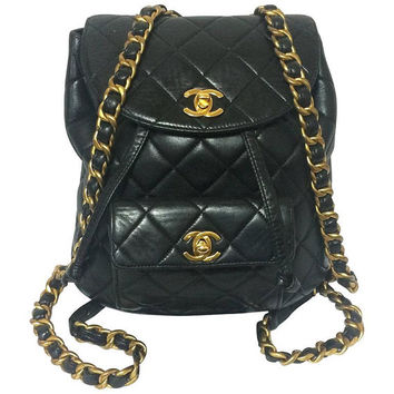 Vintage CHANEL quilted black lamb leather backpack with gold chain strap and CC closure. Classic and popular bag.