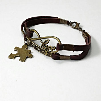Autism bracelet, autism jewelry, autism charm bracelet, autism awareness  puzzle jewelry, brown leather hope, love infinity charm bracelet.