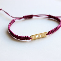 Matte Gold Love Pendant on Plum Macrame Adjustable Bracelet with Matte Gold Accent Beads