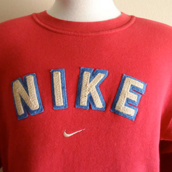 vintage 90's Nike embroidered swoosh applique beige blue logo red fleece graphic sweatshirt men women unisex crew neck pullover jumper small