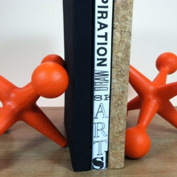 Supermarket: Large Cast Iron Jacks Bookends- 2 Metal Mid Century Modern Style Orange Industrial Jax Paperweights Doorstop or Industrial Retro Pop Art from Urban Trading Post