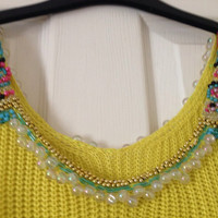 Stunning lime green knitted crop top with intricate hand beaded detailing at neckline.