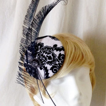 Black peacock feather sword and black and white damask derby hat fascinator hair clip