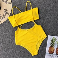 Explosive ladies split swimsuit sexy solid color irregular strap bikini