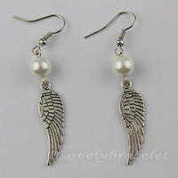 The fashionable glamour with white cat burglar earrings