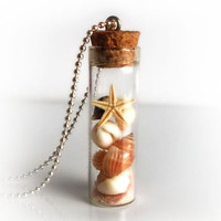 Sea shells in a bottle necklace, vial necklace with seashalls, conchs, stafish and sand